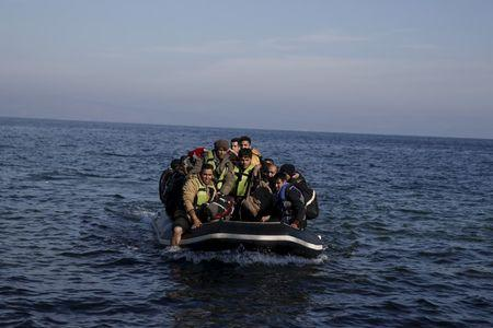 Refugees and migrants arrive on an inflatable raft on the Greek island of Lesbos