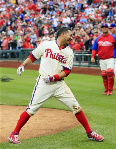 Philadelphia Phillies' Freddy Galvis, celebrates after hitting the game-winning solo home run in the ninth inning of a baseball game against the Cincinnati Reds, Sunday, May 19, 2013, in Philadelphia. The Phillies won 3-2. (AP Photo/Tom Mihalek)