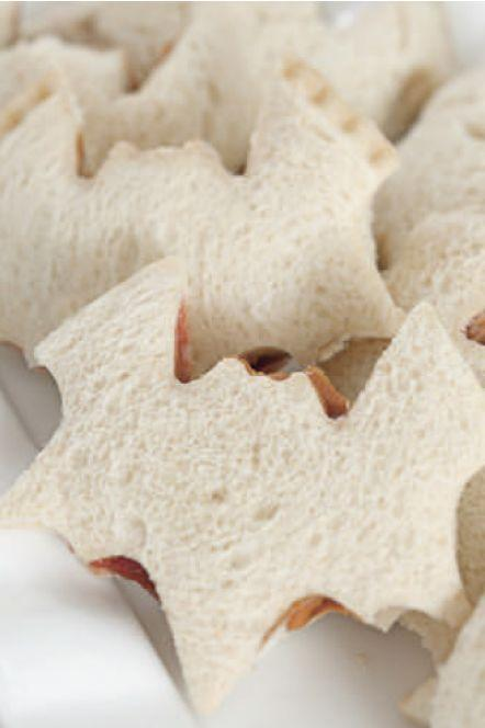 """<p>Kids and adults alike will love these bat-shaped peanut butter and jelly sandwiches.You simply can't be the classic combo.</p><p><em><a href=""""https://www.womansday.com/food-recipes/food-drinks/a28834184/bat-peanut-butter-and-jelly-sandwiches-recipe/"""" rel=""""nofollow noopener"""" target=""""_blank"""" data-ylk=""""slk:Get the Bat Peanut Butter and Jelly Sandwiches recipe."""" class=""""link rapid-noclick-resp"""">Get the Bat Peanut Butter and Jelly Sandwiches recipe.</a></em> </p>"""
