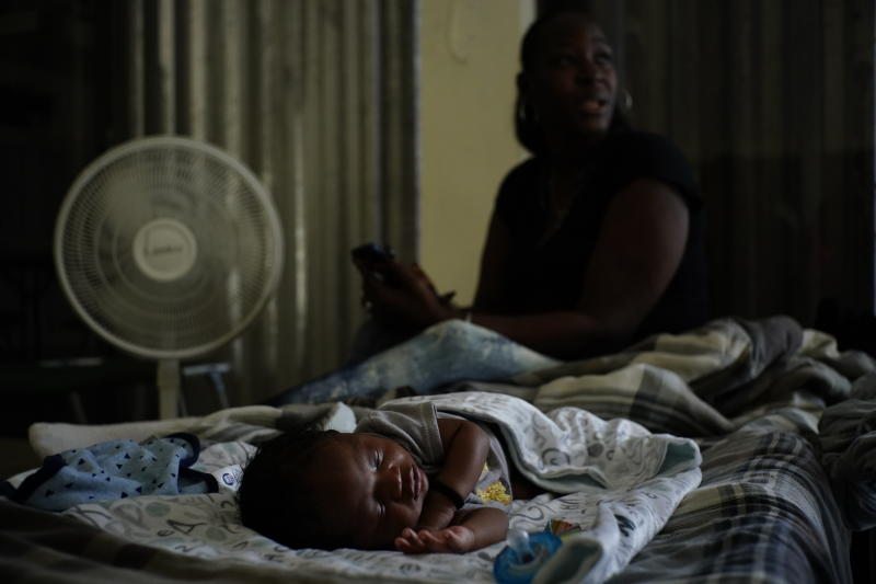 A baby sleeps inside a church that was opened up as a shelter for residents who will wait out Hurricane Dorian in Freeport on Grand Bahama, Bahamas, Sept. 1, 2019. (Photo: Ramon Espinosa/AP)