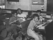 <p>Students share desks with their schoolmates at a segregated school in southeast Missouri.</p>