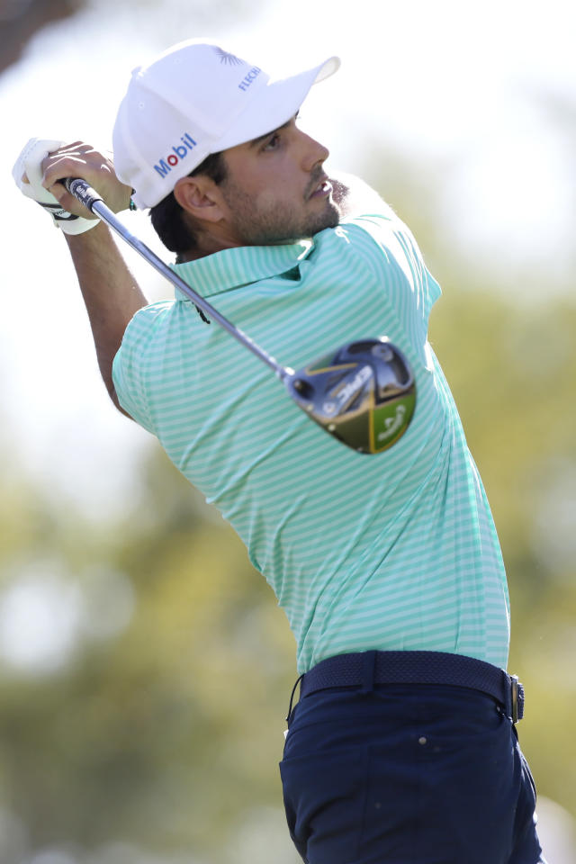 Abraham Ancer follows through on the third tee during the final round of The American Express golf tournament on the Stadium Course at PGA West in La Quinta, Calif., Sunday, Jan. 19, 2020. (AP Photo/Alex Gallardo)