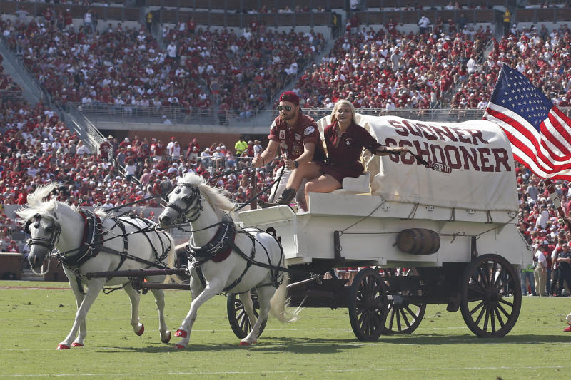 Oklahoma's Sooner Schooner is driven onto the field to celebrate a touchdown in the second quarter of an NCAA college football game against Texas Tech in Norman, Okla., Saturday, Sept. 28, 2019. (AP Photo/Sue Ogrocki)