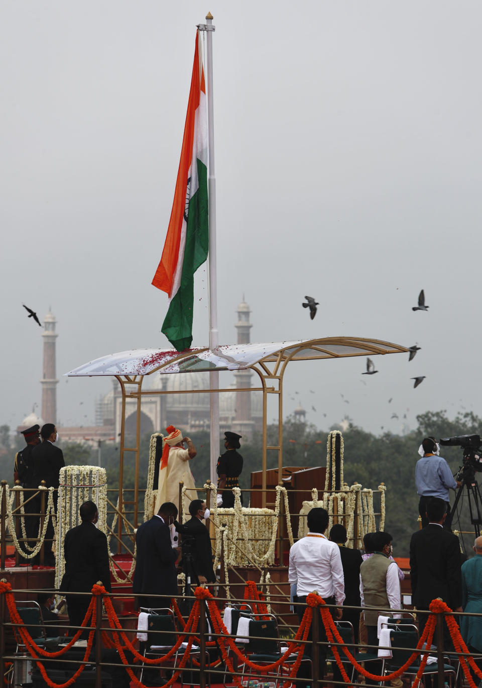 Indian Prime Minister Narendra salutes the national flag flying from the ramparts of the historic Red Fort monument on Independence Day in New Delhi, India, Saturday, Aug. 15, 2020. (AP Photo/Manish Swarup)