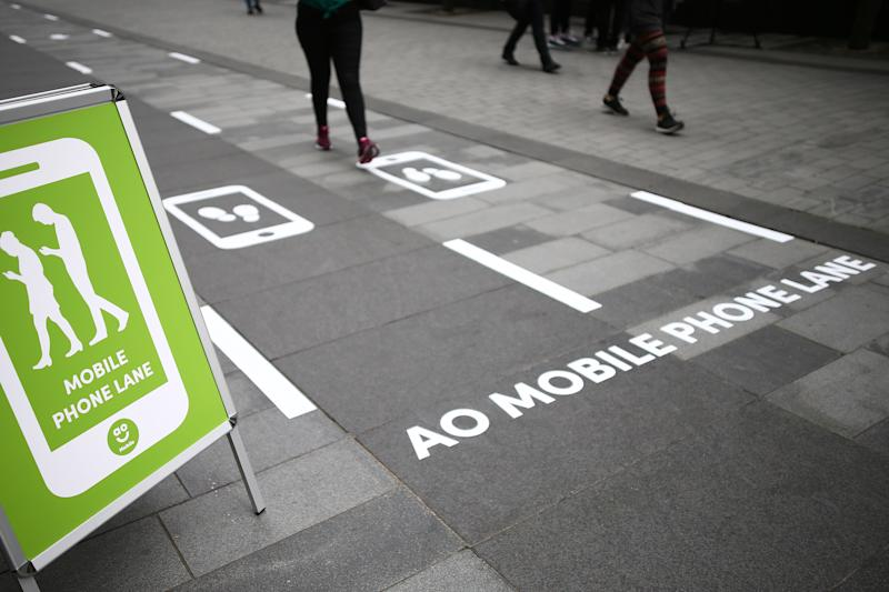 Manchester is trialling Europe's first designated mobile phone slow lanes for pedestrians (PA)