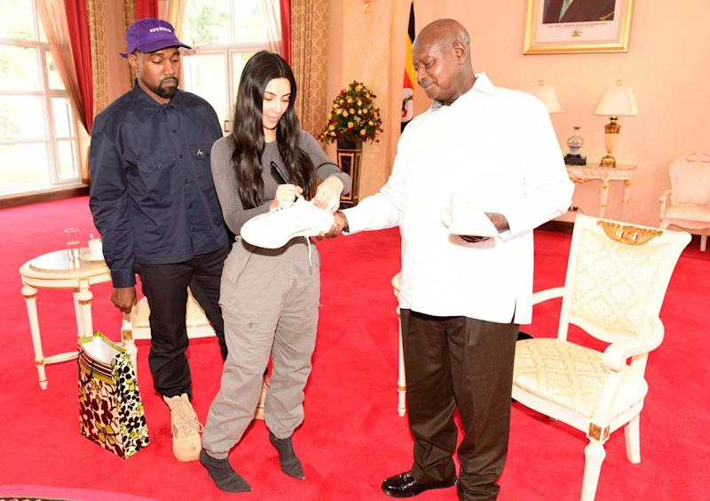 The celebrity couple signed a pair of trainers for the Ugandan president (AFP/Getty Images)