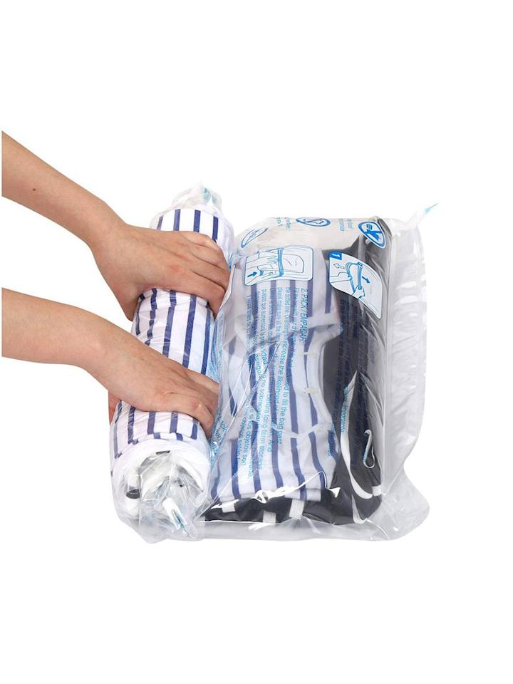 """<p>While those popular space-saving vacuum bags seem handy, they're not exactly the most convenient storage solution, which is why we love <a href=""""https://www.amazon.com/Hibag-Compression-12-Pack-Suitcase-12-Travel/dp/B07PLHBVZQ/ref=as_li_ss_tl?th=1&linkCode=ll1&tag=rslifesimplifyingproductsjmattern0519-20&linkId=a5b213b0dc544ae1c3a37e6a46a310d7&language=en_US"""" target=""""_blank"""">this simpler no-vacuum style</a>. Give each bag a gentle roll and watch it shrink down clothes, linens, and other items you need to store in your home or pack in a suitcase. You'll find so many ways to use these reusable roll-up compression bags. </p> <p><strong>To buy:</strong> $15; <a href=""""https://www.amazon.com/Hibag-Compression-12-Pack-Suitcase-12-Travel/dp/B07PLHBVZQ/ref=as_li_ss_tl?th=1&linkCode=ll1&tag=rslifesimplifyingproductsjmattern0519-20&linkId=a5b213b0dc544ae1c3a37e6a46a310d7&language=en_US"""" target=""""_blank"""">amazon.com</a>.</p>"""