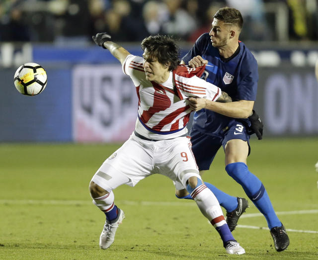 United States' Matt Miazga (3) grabs Paraguay's Federico Santander (9) during the first half of an international friendly soccer match in Cary, N.C., Tuesday, March 27, 2018. (AP Photo/Gerry Broome)