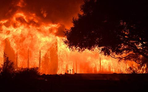 The main building at Paras Vinyards burns  - Credit: AFP