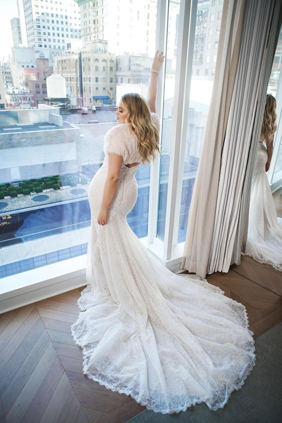<p>Lawrence wears a cropped furry bolero with her lace bridal gown by Justin Alexander. (Photo: courtesy of Justin Alexander) </p>