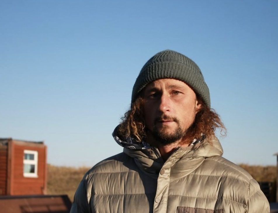 Pictured is Anton Morozov, founder of surfing school Snowave, wearing a beanie and jacket. Source: Instagram