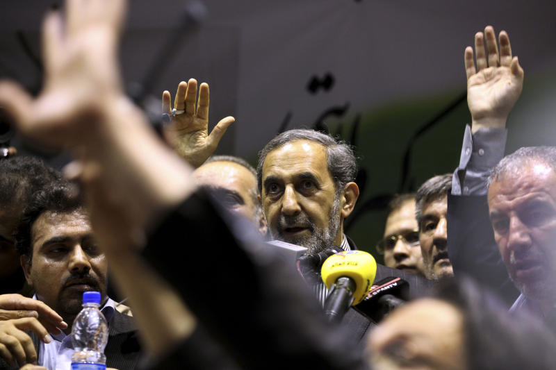 Iranian former Foreign Minister and presidential candidate Ali Akbar Velayati, center, delivers his speech in a campaign rally, two days prior to the election, in Tehran, Iran, Wednesday, June 12, 2013. (AP Photo/Vahid Salemi)