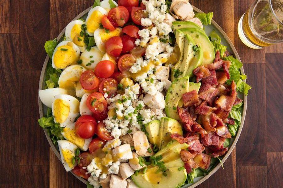 "<p>In just 20 minutes, you can make a delicious <a rel=""nofollow"" href=""https://www.womansday.com/health-fitness/g22640015/best-protein-powders-women/"">protein-packed</a> salad that'll keep you full until your next meal.</p><p><strong>Get the recipe at <a rel=""nofollow"" href=""https://www.delish.com/cooking/recipe-ideas/recipes/a58703/best-cobb-salad-recipe/"">Delish</a>.</strong><strong><br></strong></p>"