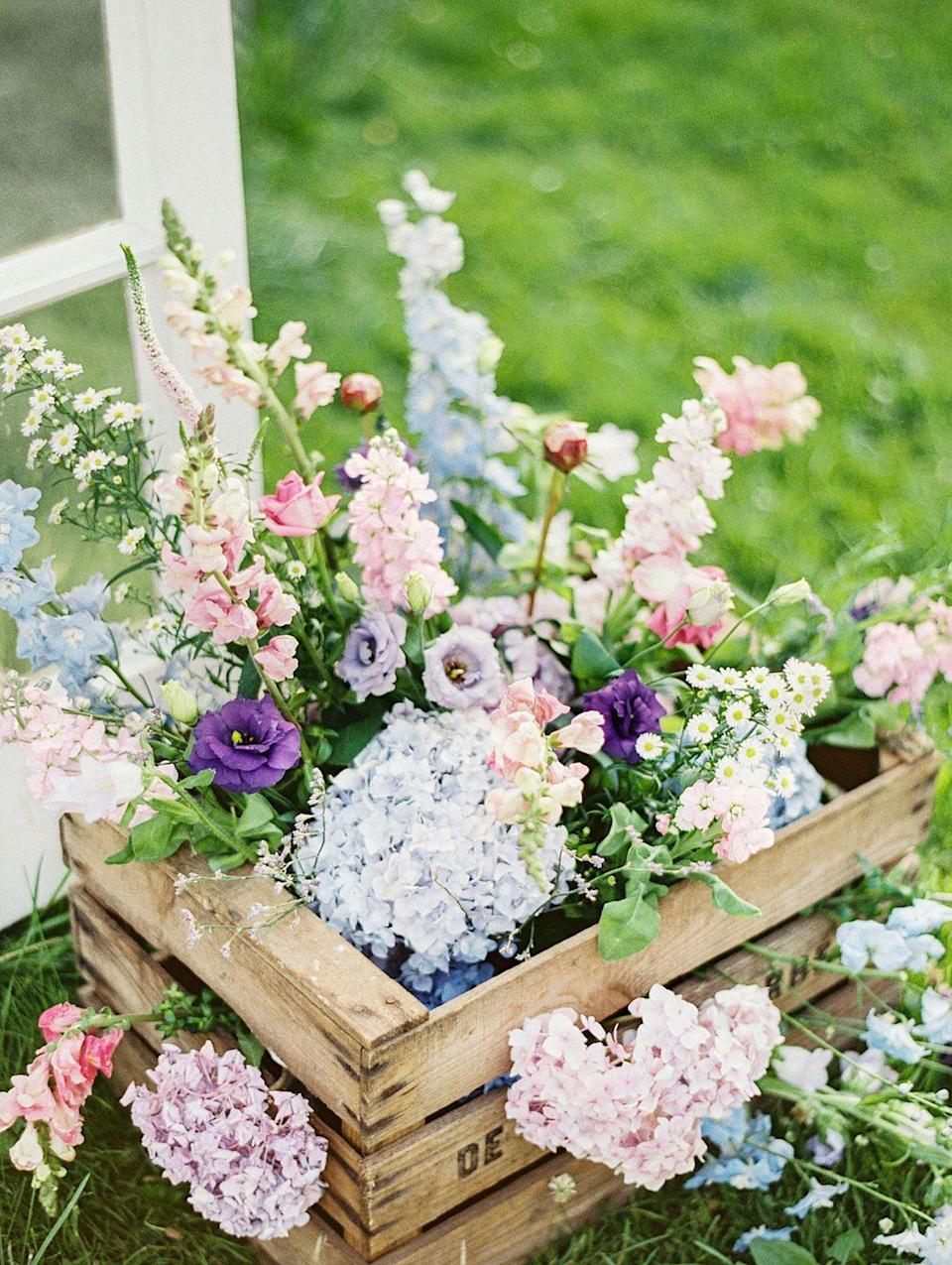 """<p>The best way to glamorize a rustic crate? Flowers. Hello, one-and-done Easter centerpiece.</p><p><a rel=""""nofollow noopener"""" href=""""https://www.amazon.com/At-Home-Main-Handmade-Rustic/dp/B07MVNL9N6/"""" target=""""_blank"""" data-ylk=""""slk:SHOP CRATES"""" class=""""link rapid-noclick-resp"""">SHOP CRATES</a></p>"""