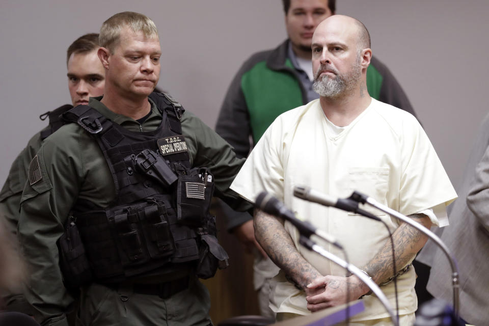 FILE - In this Wednesday, Nov. 20, 2019, file photo, Curtis Ray Watson, right, stands as a preliminary hearing is recessed in Ripley, Tenn. A prosecutor says a hearing has been set to discuss a plea deal for the Tennessee prison inmate charged with killing a corrections administrator during a 2019 escape attempt. Lauderdale County district attorney Mark Davidson told The Associated Press that a hearing has been scheduled for Monday, June 14, 2021, in the case of Watson. (AP Photo/Mark Humphrey, Pool, File)