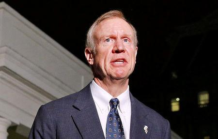 FILE PHOTO: Illinois Gov-elect Bruce Rauner speaks to media after meeting Obama and other Governor-elects at the White House