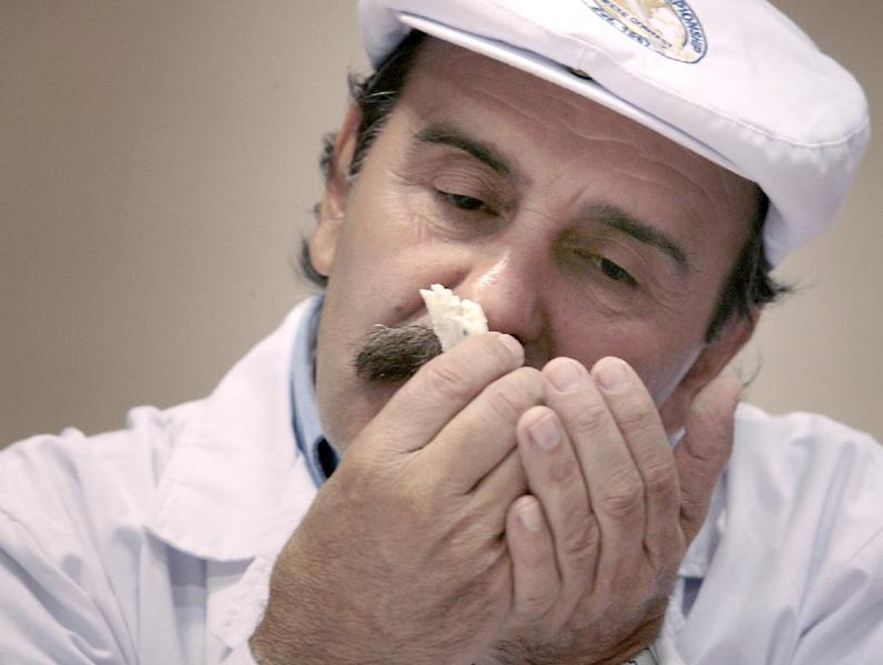 Judge Roberto Castenega of Argentina, samples the aroma of one of the entries in the Semi-soft Goat's Milk Cheese category during the opening day of the World Championship Cheese Contest at the Monona Terrace Convention Center in Madison, Wis. on Monday, March 5, 2012. More than 2,500 entries will be judged throughout the three day gathering, sponsored every two years by the Wisconsin Cheese Makers Association. (AP Photo/Wisconsin State Journal, John Hart )