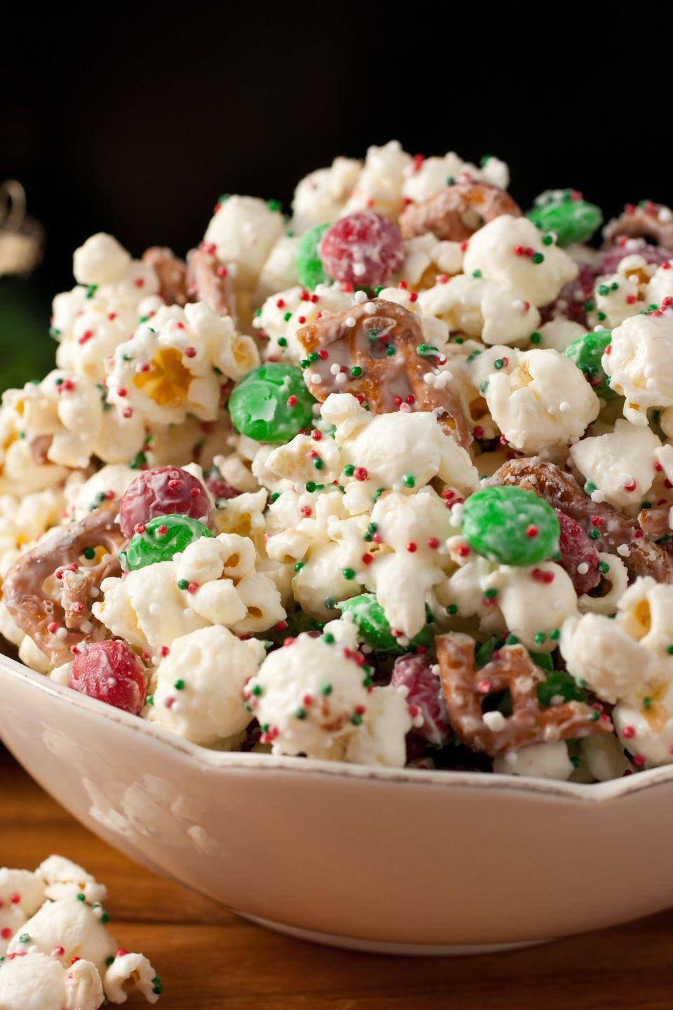"""<p>Add vanilla candy melts, pretzel pieces, and festively colored M&M's and sprinkles to a bag of popcorn to create this cheery snack. </p><p><strong>Get the recipe at <a href=""""http://www.cookingclassy.com/2012/12/christmas-crunch-funfetti-popcorn-christmas-style/"""" rel=""""nofollow noopener"""" target=""""_blank"""" data-ylk=""""slk:Cooking Classy"""" class=""""link rapid-noclick-resp"""">Cooking Classy</a>.</strong></p>"""