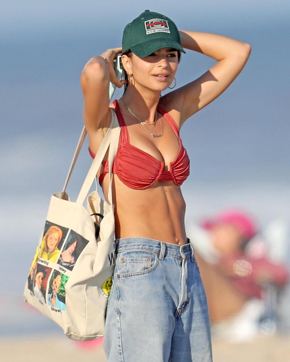 <p>Another day, another beach visit for Emily Ratajkowski, who makes her way toward the surf in The Hamptons, New York, on Thursday.</p>