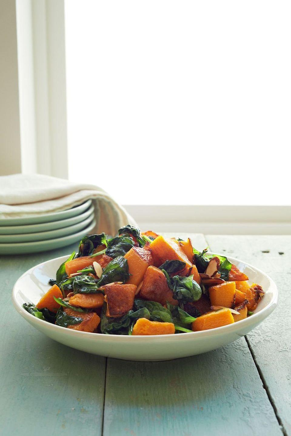 """<p>Folding fresh spinach into roasted butternut squash makes the leaves warm and wilty, and sprinkling the dish with almonds adds irresistible crunch.</p><p><em><a href=""""https://www.goodhousekeeping.com/food-recipes/a15496/roasted-butternut-squash-spinach-recipe-wdy0114/"""" rel=""""nofollow noopener"""" target=""""_blank"""" data-ylk=""""slk:Get the recipe for Roasted Butternut Squash and Spinach »"""" class=""""link rapid-noclick-resp"""">Get the recipe for Roasted Butternut Squash and Spinach »</a></em></p><p><strong>RELATED: </strong><a href=""""https://www.goodhousekeeping.com/food-recipes/cooking/tips/g2091/prepare-cook-butternut-squash/"""" rel=""""nofollow noopener"""" target=""""_blank"""" data-ylk=""""slk:How to Peel and Cut Butternut Squash in a Few Easy Steps"""" class=""""link rapid-noclick-resp"""">How to Peel and Cut Butternut Squash in a Few Easy Steps</a></p>"""