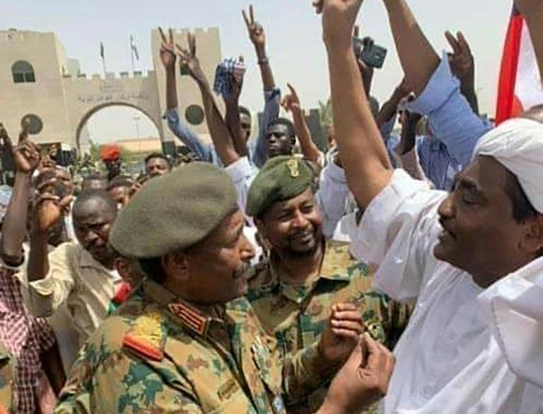 Hours before Burhan was named as Sudan's military ruler in April, he was seen talking to protesters taking part in a long-running sit-in outside army headquarters in Khartoum (AFP Photo/-)