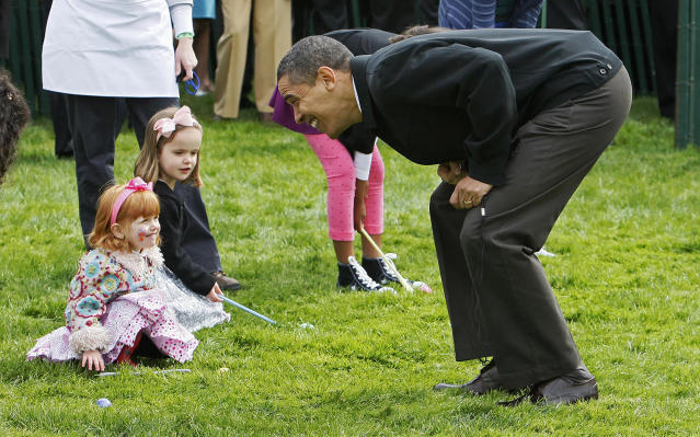 <p>President Barack Obama cheers on children before blowing the whistle to start the White House Easter Egg Roll on the South Lawn of the White House in Washington, Monday, April 13, 2009. (Photo: Charles Dharapak/AP) </p>
