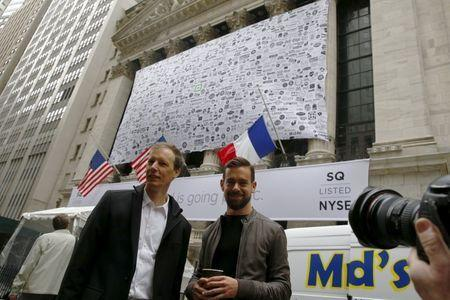 Jack Dorsey, (R) CEO of Square and CEO of Twitter, poses as he arrives at the New York Stock Exchange for the IPO of Square Inc., in New York November 19, 2015. REUTERS/Lucas Jackson