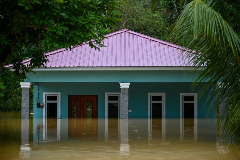 A house is seen partially submerged in Semantan in Malaysia's Pahang state