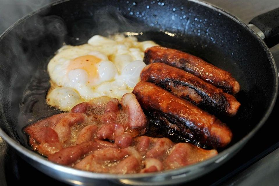 Egg, sausages and bacon being fried in a frying pan (Nick Ansell/PA) (PA Archive)