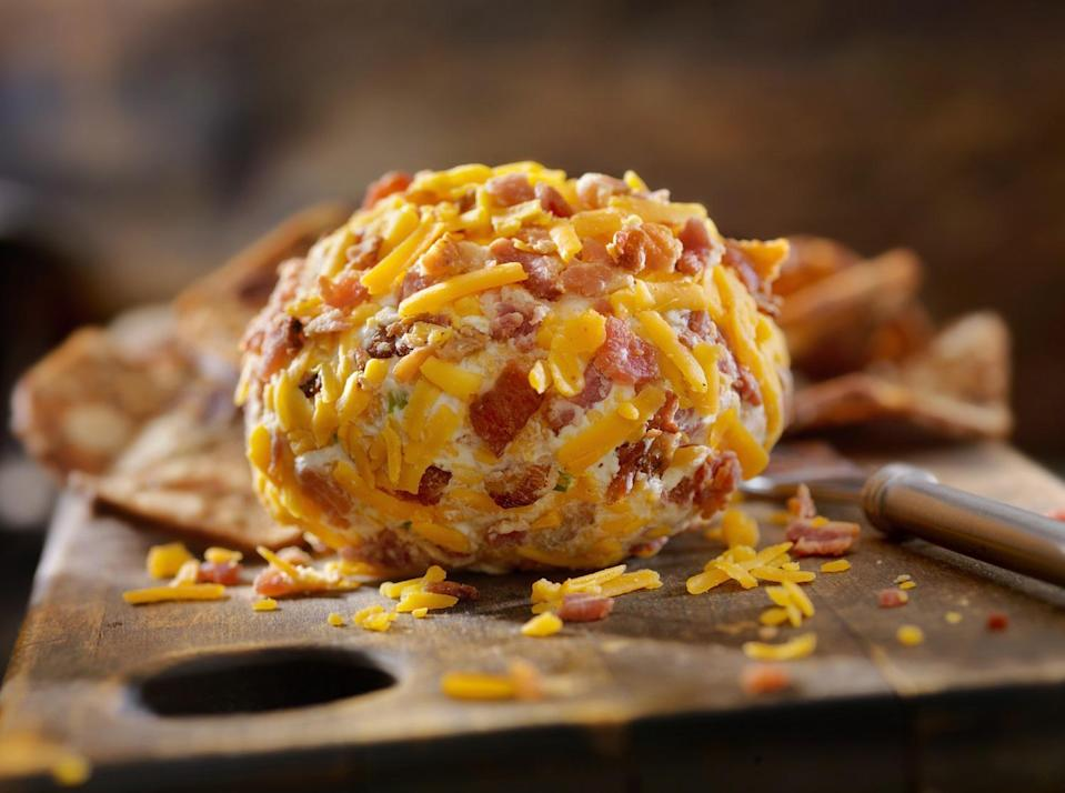 """<p>Cheese balls are one of those <a href=""""https://www.thedailymeal.com/cook/best-retro-recipes-gallery?referrer=yahoo&category=beauty_food&include_utm=1&utm_medium=referral&utm_source=yahoo&utm_campaign=feed"""" rel=""""nofollow noopener"""" target=""""_blank"""" data-ylk=""""slk:retro dishes nobody makes anymore (but should)"""" class=""""link rapid-noclick-resp"""">retro dishes nobody makes anymore (but should)</a>. This cream cheese concoction has the added benefit of highlighting one of the most beloved food combinations: bacon and cheddar.</p> <p><a href=""""https://www.thedailymeal.com/recipes/crispy-bacon-cheddar-cheese-ball-recipe?referrer=yahoo&category=beauty_food&include_utm=1&utm_medium=referral&utm_source=yahoo&utm_campaign=feed"""" rel=""""nofollow noopener"""" target=""""_blank"""" data-ylk=""""slk:For the Cheddar Bacon Cheese Ball recipe, click here."""" class=""""link rapid-noclick-resp"""">For the Cheddar Bacon Cheese Ball recipe, click here.</a></p>"""