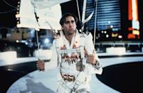 "<p>One of Hollywood's most famously devoted Elvis fans, <a href=""https://www.yahoo.com/movies/tagged/nicolas-cage"" data-ylk=""slk:Cage"" class=""link rapid-noclick-resp"">Cage</a> received a <a href=""https://www.yahoo.com/movies/tagged/golden-globes"" data-ylk=""slk:Golden Globe"" class=""link rapid-noclick-resp"">Golden Globe</a> nomination for this comedy about a man whose Vegas marriage plans go all wrong — until he wins he back fiancée <a href=""https://www.yahoo.com/movies/tagged/sarah-jessica-parker"" data-ylk=""slk:Sarah Jessica Parker"" class=""link rapid-noclick-resp"">Sarah Jessica Parker</a> by — spoiler alert! — joining a team of skydiving Elvis impersonators. —<em>Gwynne Watkins</em> (Photo: Columbia/Everett Collection) </p>"