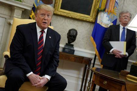 U.S. President Donald Trump speaks to reporters with National Security Adviser John Bolton looking on in the Oval Office at the White House in Washington, May 3, 2019. REUTERS/Jonathan Ernst