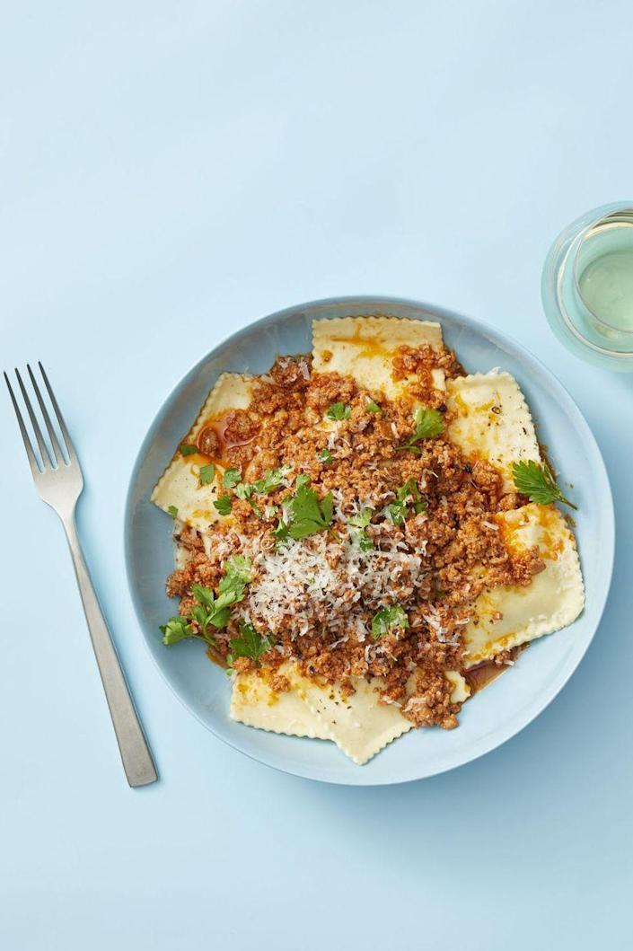 """<p>Dress up store-bought cheese ravioli with a quick-fire ragu that's ready in just 15 minutes.</p><p><a href=""""https://www.goodhousekeeping.com/food-recipes/easy/a25657117/quick-pork-ragu-with-ravioli-recipe/"""" rel=""""nofollow noopener"""" target=""""_blank"""" data-ylk=""""slk:Get the recipe for Quick Pork Ragu with Ravioli »"""" class=""""link rapid-noclick-resp""""><em>Get the recipe for Quick Pork Ragu with Ravioli »</em></a></p>"""