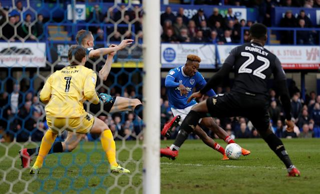 "Soccer Football - League One - Portsmouth vs Wigan Athletic - Fratton Park, Portsmouth, Britain - April 2, 2018 Portsmouth's Jamal Lowe scores their second goal Action Images/Matthew Childs EDITORIAL USE ONLY. No use with unauthorized audio, video, data, fixture lists, club/league logos or ""live"" services. Online in-match use limited to 75 images, no video emulation. No use in betting, games or single club/league/player publications. Please contact your account representative for further details."