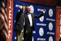 Vice President Mike Pence, left, stands next to U.S. Rep. Jeff Duncan on stage, Monday, Aug. 26, 2019, in Anderson, S.C. Pence was the headlining speaker at an annual fundraiser hosted by Duncan. (AP Photo/Meg Kinnard)