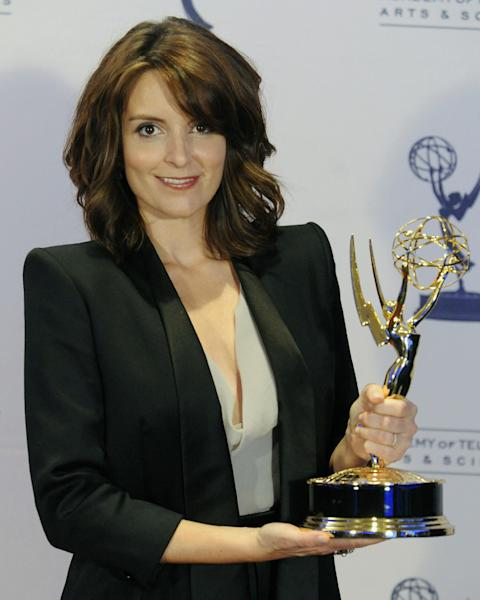 "FILE - In this Sept. 12, 2009 file photo, Tina Fey poses backstage with her Emmy for Outstanding Guest Actress in a Comedy Series for her turn as former Alaska Gov. Sarah Palin on ""Saturday Night Live,"" at the Creative Arts Emmy Awards in Los Angeles. Television looks like the land of female opportunity with the success of shows like ""Girls"" and ""New Girl"" and the achievements of actor-writers including Tina Fey and Lena Dunham. but making TV remains largely man's work. (AP Photo/Chris Pizzello, File)"