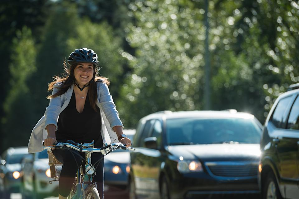 A woman passing traffic on her bike. Source: Getty Images