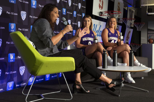 Washington head coach Jody Wynn, left, along with players Amber Melgoza and Missy Peterson speak to reporters during the Pac-12 Conference women's NCAA college basketball media day, Monday, Oct. 7, 2019, in San Francisco. (AP Photo/D. Ross Cameron)