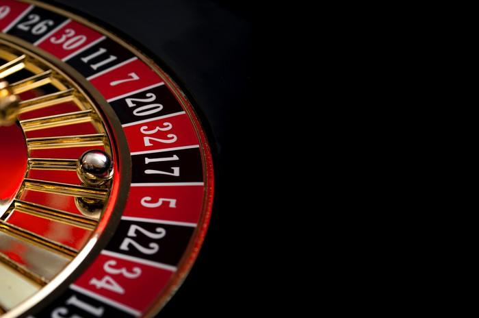 A roulette wheel on a black background