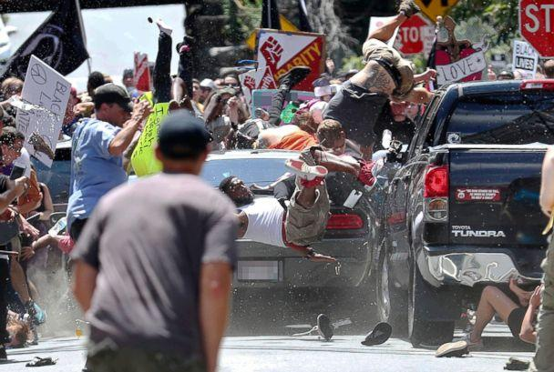 PHOTO: People fly into the air as a vehicle drives into a group of protesters demonstrating against a white nationalist rally in Charlottesville, Va., Aug. 12, 2017. (Ryan M. Kelly/The Daily Progress via AP)