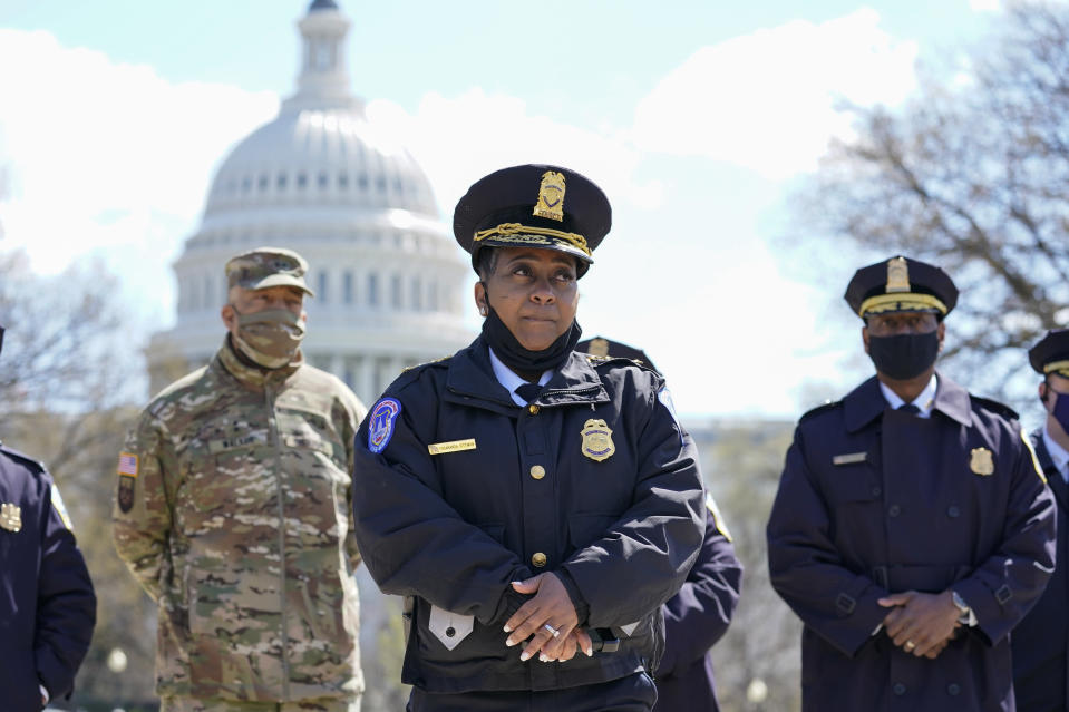 Acting chief of the U.S. Capitol Police Yogananda Pittman listens during a news conference after a car crashed into a barrier on Capitol Hill near the Senate side of the U.S. Capitol in Washington, Friday, April 2, 2021.(AP Photo/Alex Brandon)