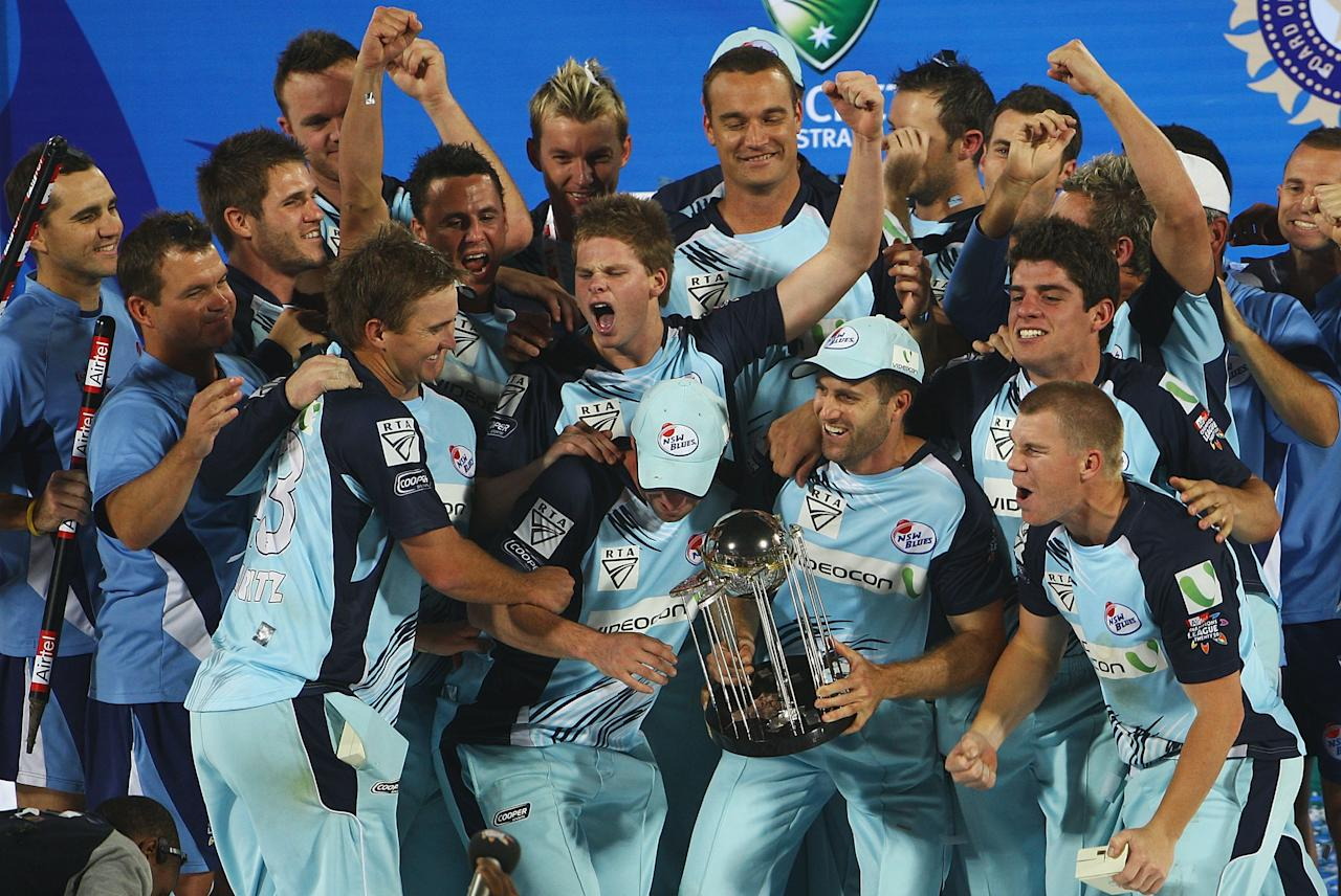 HYDERABAD, INDIA - OCTOBER 23:  NSW players celebrate winning the Airtel Champions League Twenty20 Final between NSW and Trinidad & Tobago at the Rajiv Gandhi International Stadium  on October 23, 2009 in Hyderabad, India.  (Photo by Matt Lewis - GCV/GCV via Getty Images)