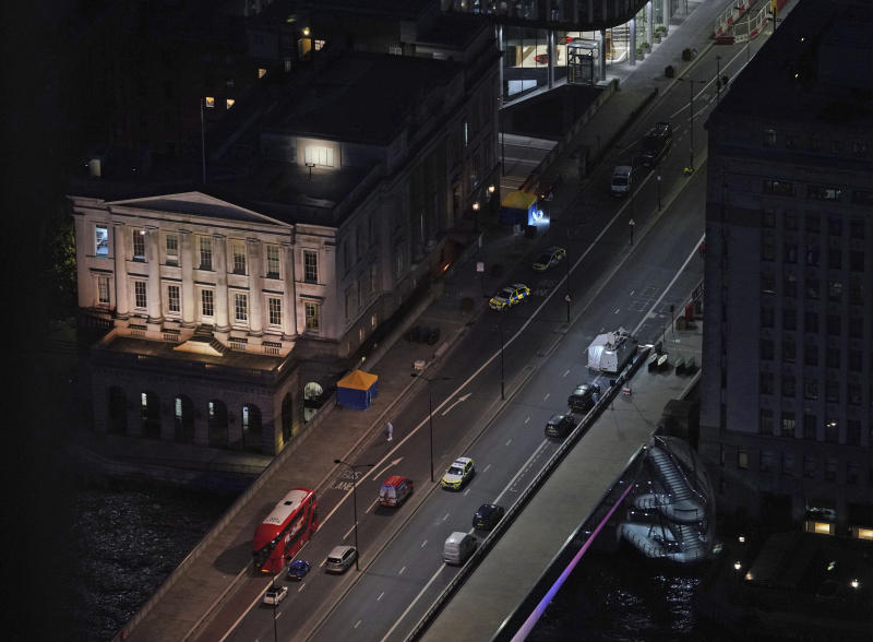 The scene on London Bridge in central London, Saturday, Nov. 30, 2019, after an attack on London Bridge on Friday. UK counterterrorism police on Saturday searched for clues into how a man imprisoned for terrorism offenses before his release last year managed to stab several people before being tackled by bystanders and shot dead by officers on London Bridge. Two people were killed and three wounded. (Yui Mok/PA via AP)
