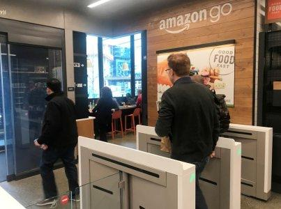 FILE PHOTO: A customer walks out of the Amazon Go store, without needing to pay at a cash register due to cameras, sensors and other technology that track goods that shoppers remove from shelves and bill them automatically after they leave, in Seattle, Washington, U.S., January 18, 2018. REUTERS/Jeffrey Dastin/File Photo