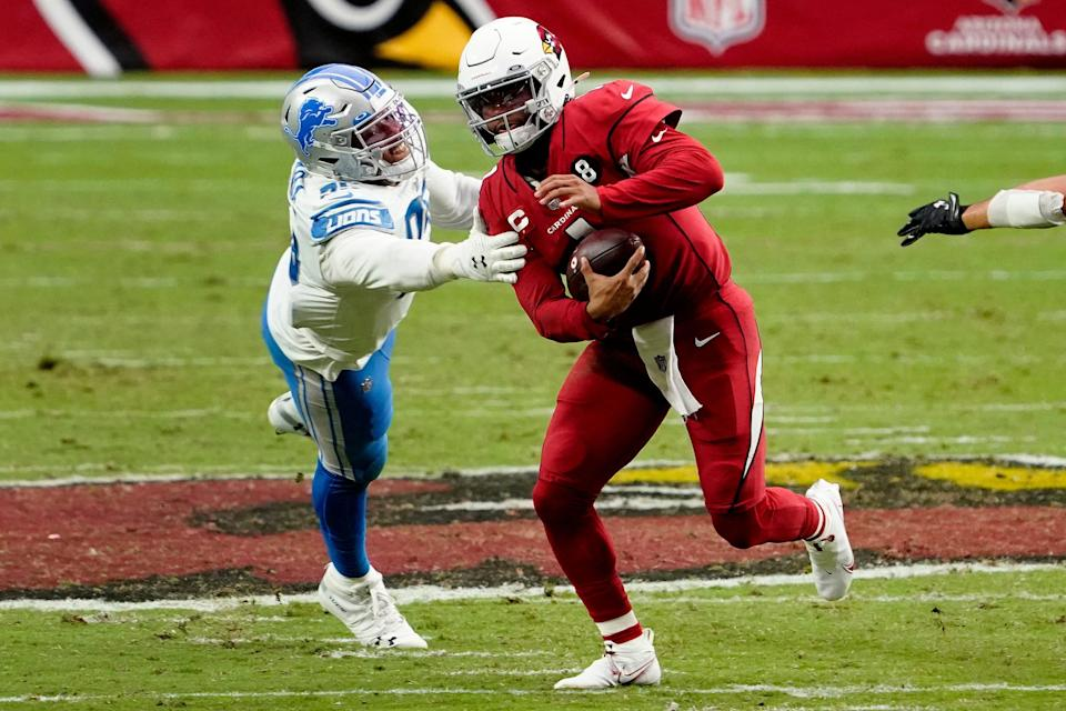 Cardinals quarterback Kyler Murray, right, escapes the reach of Lions defensive end Romeo Okwara during the second half on Sunday, Sept. 27, 2020, in Glendale, Ariz.