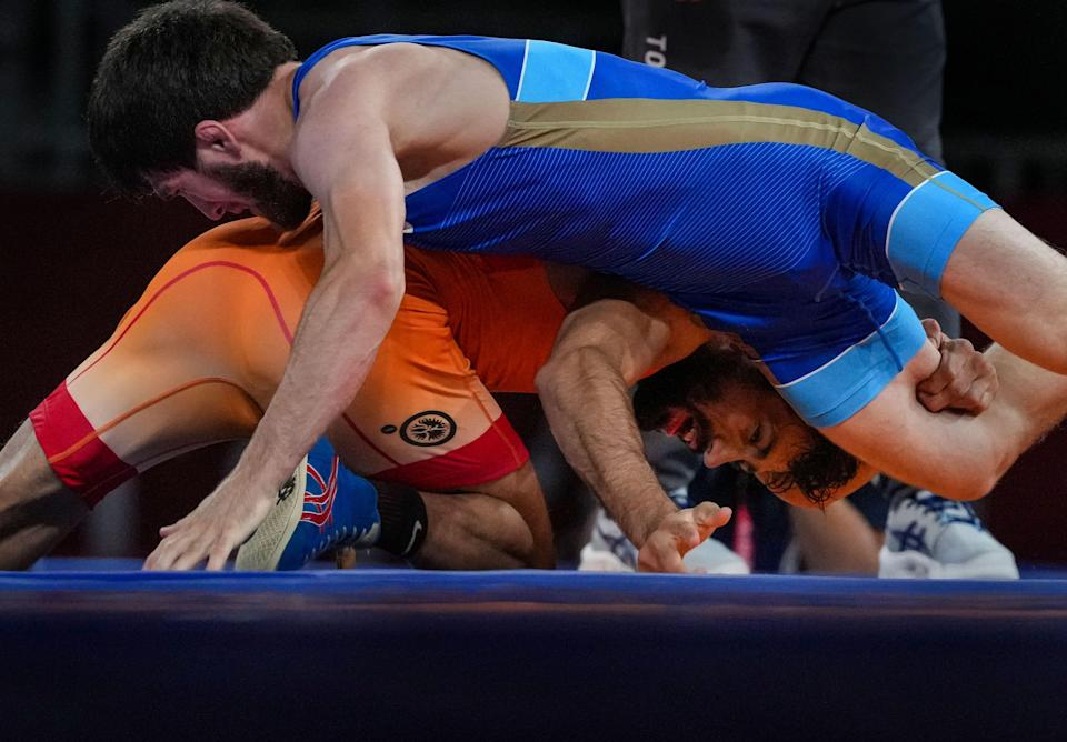 """<div class=""""paragraphs""""><p>India's Ravi Dahiya against Zavur Uguev of Russian Olympic Committee during the Tokyo Olympics gold medal match.</p></div>"""