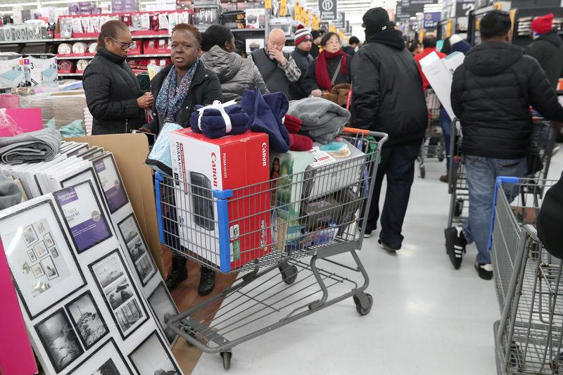 FILE PHOTO: People shop inside a Walmart during a sales event on Thanksgiving day in Westbury, New York