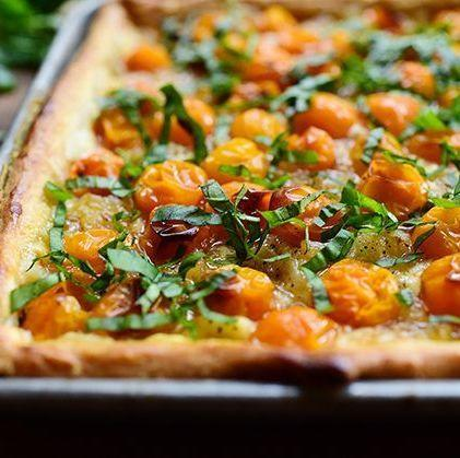 """<p>""""This was one of the most delicious things I've ever eaten,"""" Ree says of the tomato tart pictured here. But dreamy as it is, it's not the only way to enjoy tomatoes. This summer, why not celebrate with a menu that's completely tomato-themed? Our best <a href=""""https://www.thepioneerwoman.com/food-cooking/meals-menus/g36500577/tomato-recipes"""" rel=""""nofollow noopener"""" target=""""_blank"""" data-ylk=""""slk:tomato recipes"""" class=""""link rapid-noclick-resp"""">tomato recipes</a> can help.</p><p><a href=""""https://www.thepioneerwoman.com/food-cooking/recipes/a11807/tomato-tart/"""" rel=""""nofollow noopener"""" target=""""_blank"""" data-ylk=""""slk:Get the recipe"""" class=""""link rapid-noclick-resp""""><strong>Get the recipe</strong></a>.</p><p><a class=""""link rapid-noclick-resp"""" href=""""https://go.redirectingat.com?id=74968X1596630&url=https%3A%2F%2Fwww.walmart.com%2Fip%2FPioneer-Woman-Nonstick-Aluminum-Cookie-Sheet-11-x-17%2F723676077&sref=https%3A%2F%2Fwww.thepioneerwoman.com%2Fjust-for-fun%2Fg36599700%2Fsummer-party-ideas%2F"""" rel=""""nofollow noopener"""" target=""""_blank"""" data-ylk=""""slk:SHOP SHEET PANS"""">SHOP SHEET PANS</a></p>"""