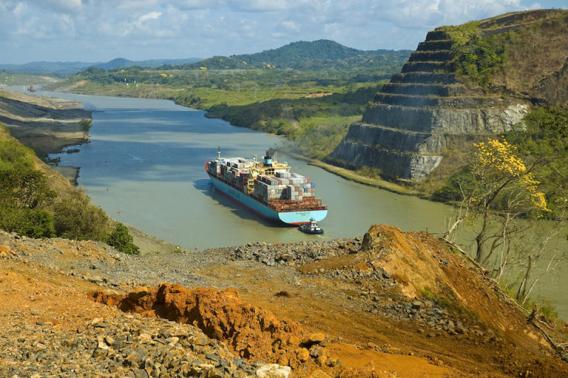 A cargo ship passing through the Panama Canal goes past volcanic rocks that helped form the Isthmus of Panama.