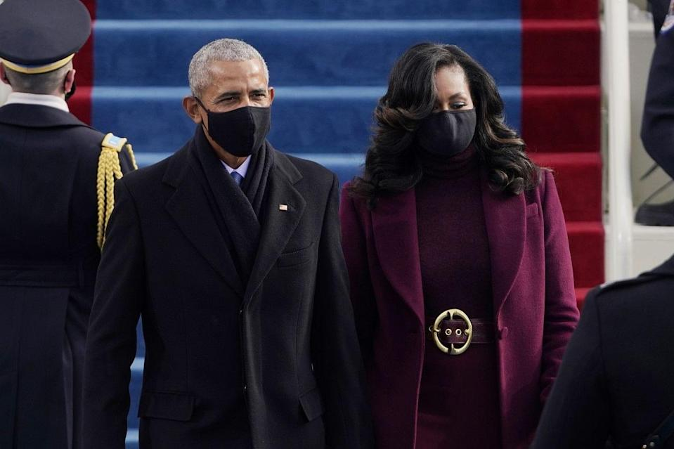 Former President Barack Obama and his wife Michelle arrive for the 59th Presidential Inauguration at the US Capitol for President-elect Joe Biden in Washington .